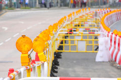Safety Lamp. & Water Filled Barrier on the Road Stock Image