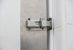 Safety latch or locked doors in condo.  Royalty Free Stock Image