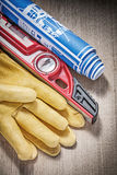 Safety leather gloves construction level drawings on wood board Stock Photo