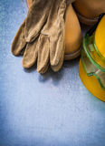 Safety leather shoes protective gloves building helmet and trans Royalty Free Stock Photography