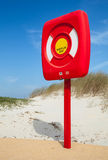 Safety life buoy in red case on the beach Stock Image