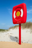 Safety life buoy in red case on the beach Royalty Free Stock Photography