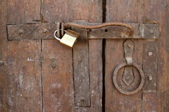 Safety lock with locked door Royalty Free Stock Photo
