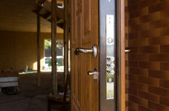 Free Safety Lock On A New Wooden Front Door Stock Images - 46057654