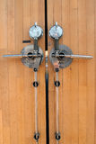 Safety lock on a wooden door. Near a bank Royalty Free Stock Images