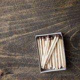 Safety matches on wooden table Stock Image