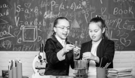 Safety measures for providing safe chemical reaction. Genius kids work on own chemical theory. Basic knowledge of. Chemistry. Pupils cute girls use test tubes stock images