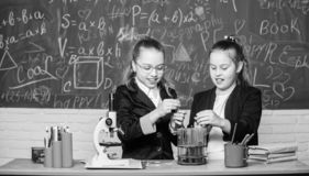 Safety measures for providing safe chemical reaction. Make studying chemistry interesting. Basic knowledge of chemistry. Pupils cute girls use test tubes with stock image