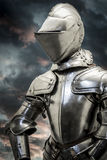 Safety.Medieval armor over clouds background. Concept of firewal Royalty Free Stock Photos