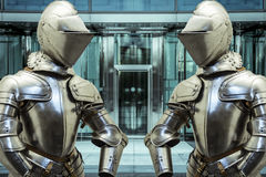 Safety.Medieval armor protecting a business building. Concept of Stock Photography