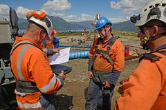 Safety meeting on confined spaces. MOANA, NEW ZEALAND, OCTOBER 27, 2017: The safety officer conducts a safety meeting at an abandoned oil well before sending royalty free stock photo