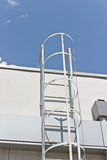 Safety metal ladder to the roof Stock Photography