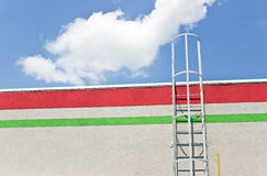 Safety metal ladder to the roof Royalty Free Stock Photo
