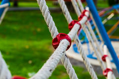 Safety net. Detail of safety net in playground area, selective focus royalty free stock photo