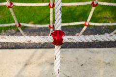 Safety net. Detail of safety net in playground area, selective focus stock images