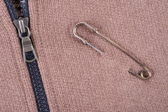 Safety pin on clothes Royalty Free Stock Image