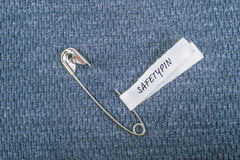 Safety pin on clothes as a symbol of solidarity Royalty Free Stock Photos