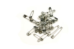 Safety pins. On a white background Royalty Free Stock Image