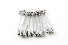 Safety pins. Isolated on white background Royalty Free Stock Image