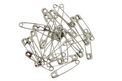 Safety Pins. Pile of silver saftey pins isolated on white Royalty Free Stock Images