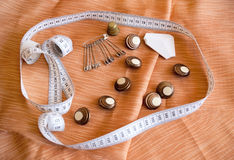Safety pins, buttons and measuring tape. Selective focus Stock Photos