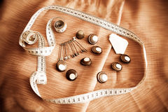 Safety pins, buttons and measuring tape. Vintage style Royalty Free Stock Images