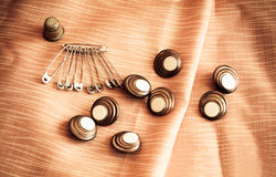 Safety pins and  buttons. Vintage style Royalty Free Stock Photography