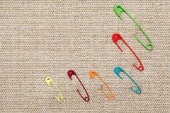 Safety Pins On Canvas Stock Photography