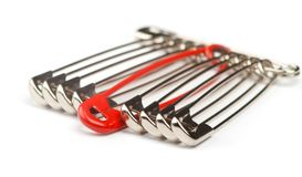 Safety pins with one red Royalty Free Stock Images