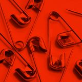 Safety pins in red Royalty Free Stock Image