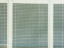 Safety protection of  windows in sporting hall. Window covered  with woven safety net. Stock Photo