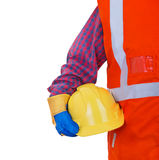 Safety Protective Work Equipment. Worker in orange vest holding yellow helmet Royalty Free Stock Photo