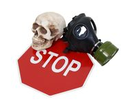 Safety protest. Rubber gas mask to protect the wearer from airborne pollutants and toxic gases, skull and a stop sign used to protest safety regulations and Royalty Free Stock Photos