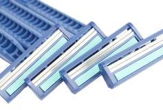Safety razor. Four isolated blue safety razor Stock Images