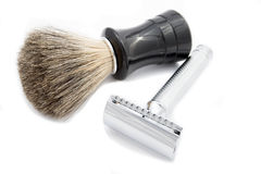 Safety razor with a badger shaving brush. On white background royalty free stock images