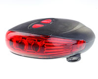 Safety red light for bicycle on  white background. Stock Photo