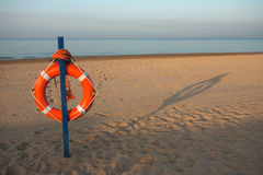Safety Ring. On beach on sunny morning stock images