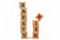 Safety and Risk word written on cube shape. Royalty Free Stock Photos