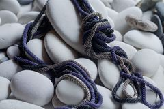 Safety rope for mountaineering. Lying and standing out against the background of white sea pebbles Stock Photography