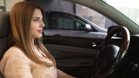 Safety rules, pretty woman sitting in automobile, no seatbelt fastened, closeup. Stock photo Stock Photos