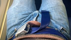 The safety seat belt in airplane stock images