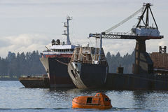 Safety ship and commercial vessel in Vancouver Royalty Free Stock Photos