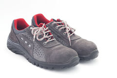 Safety shoes. On white background Royalty Free Stock Photo