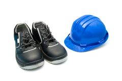 Safety Shoes and blue helmet. Isolated safety shoes and blue helmet for workers Stock Photo