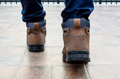 Safety shoes with forward step Royalty Free Stock Photos