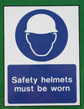 Safety sign. Hard hat safety sign on building site Stock Photos