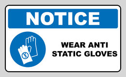 Safety sign, Hand protection must be worn. Wear anti static gloves symbol in blue circle. Safety sign, Hand protection must be worn. Information, mandatory stock illustration