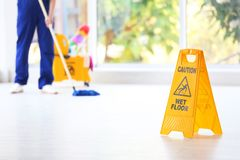 Safety sign with phrase Caution wet floor royalty free stock photo