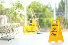 Safety sign with phrase Caution wet floor royalty free stock photography