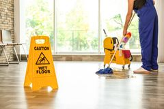 Safety sign with phrase Caution wet floor royalty free stock image